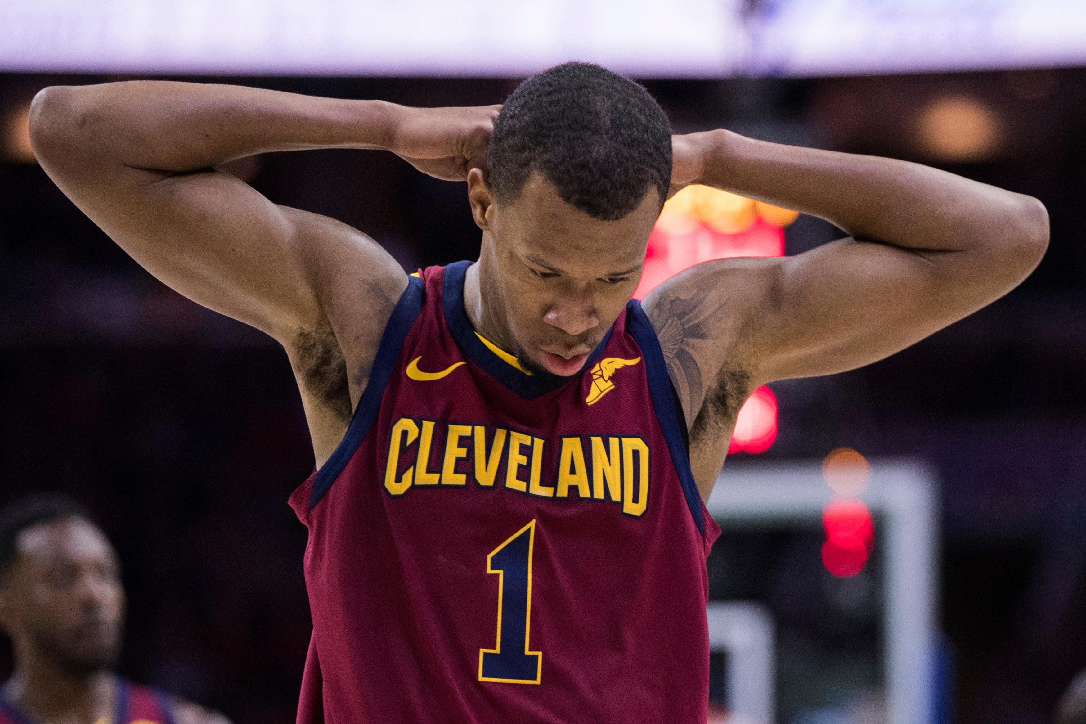 File-This April 6, 2018, file photo shows Cleveland Cavaliers' Rodney Hood reacting during the first half of an NBA basketball game against the Philadelphia 76ers, in Philadelphia.  Hood's most notable moment in these playoffs happened while sitting on the bench. He's getting up and getting in. Looking for an offensive weapon to negate Golden State's size and ability to switch on defense, Cavaliers coach Tyronn Lue is expected to play Hood in Game 3 of the NBA Finals Wednesday, June 6, 2018, in hopes of cutting into the Warriors' series lead. (AP Photo/Chris Szagola, File)