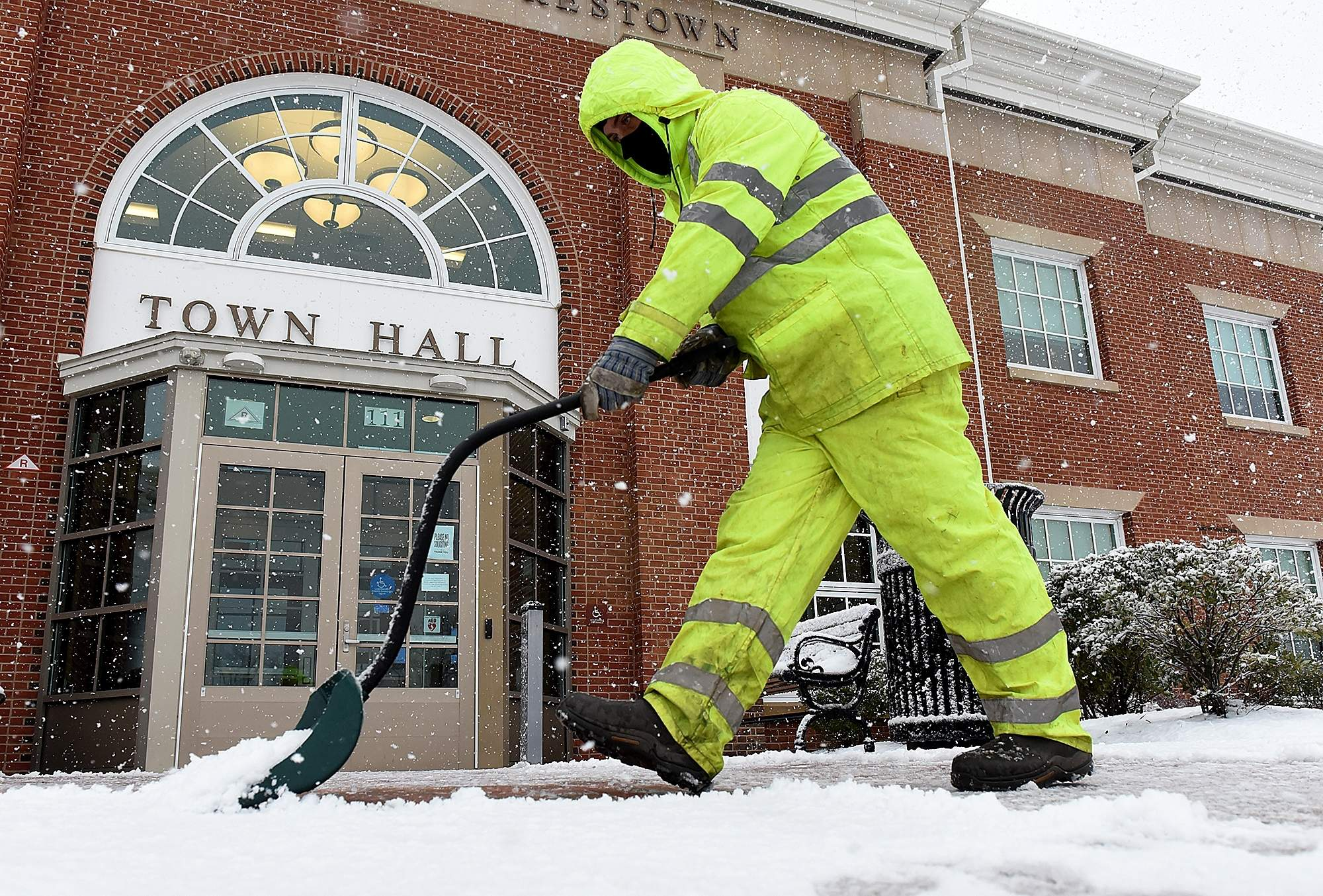 Lance Goins, employed with moorestown township Public Works Department, shovels the sidewalk around Town hall, on Wednesday, March 7, 2018, as heavier snow starts to fall. [NANCY ROKOS / STAFF PHOTOJOURNALIST]