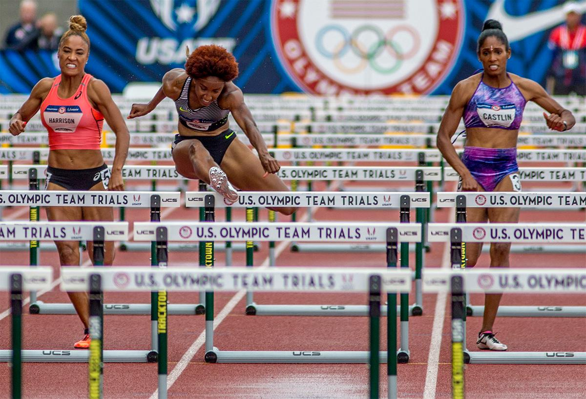 Nike's Brianna Rollins soars over the hurdles on her path to victory. Rollins won in 12.34. Photo by August Frank, Oregon News Lab