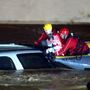 Man pulled from flooding car during water rescue