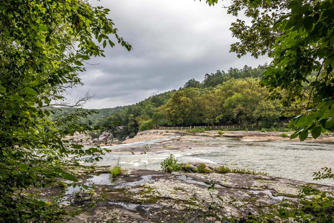 Stop #4: Eagle Falls / ADDRESS: 7351 KY-90, Corbin, KY (40701) / Cumberland Falls State Resort Park is also home to Eagle Falls, a 44-foot waterfall reached by a moderate loop trail. The 1.8-mile trail (marked Trail 9) has a 633-foot elevation gain and may not be suited for dogs or small children. There are a lot of stairs to climb that take you through some diverse terrain. It's worth the trek, though, as it leads to the beautiful Eagle Falls and its natural swimming hole. / Image: Catherine Viox // Published: 9.28.20