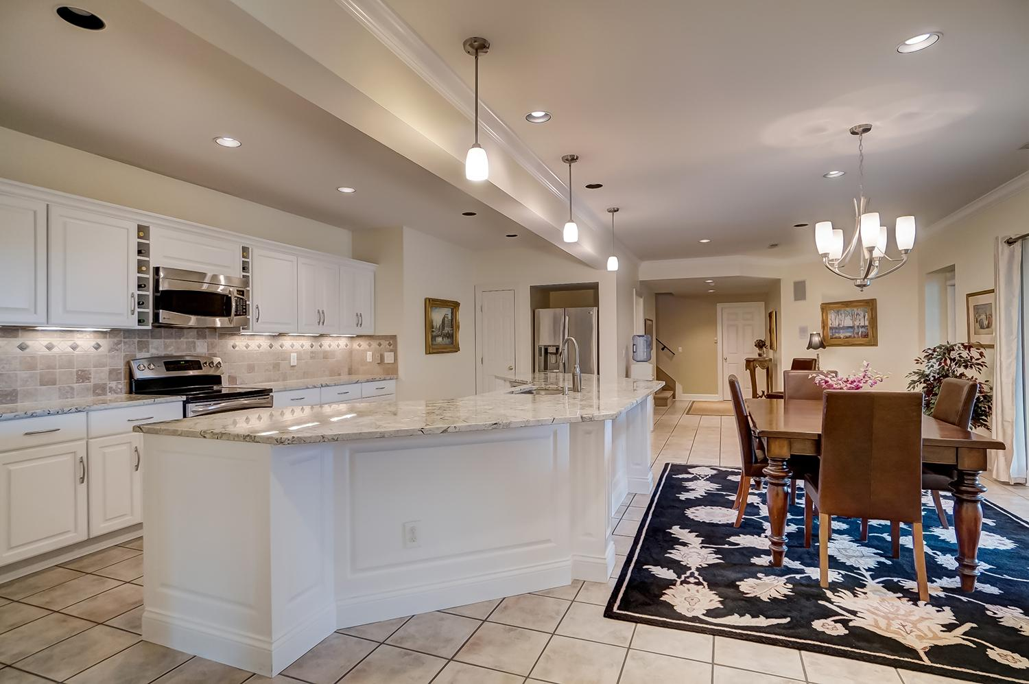 Lower-level second kitchen which is perfect for serving up parties for pool guests / Image: Wow Video Tours // Published: 6.8.18