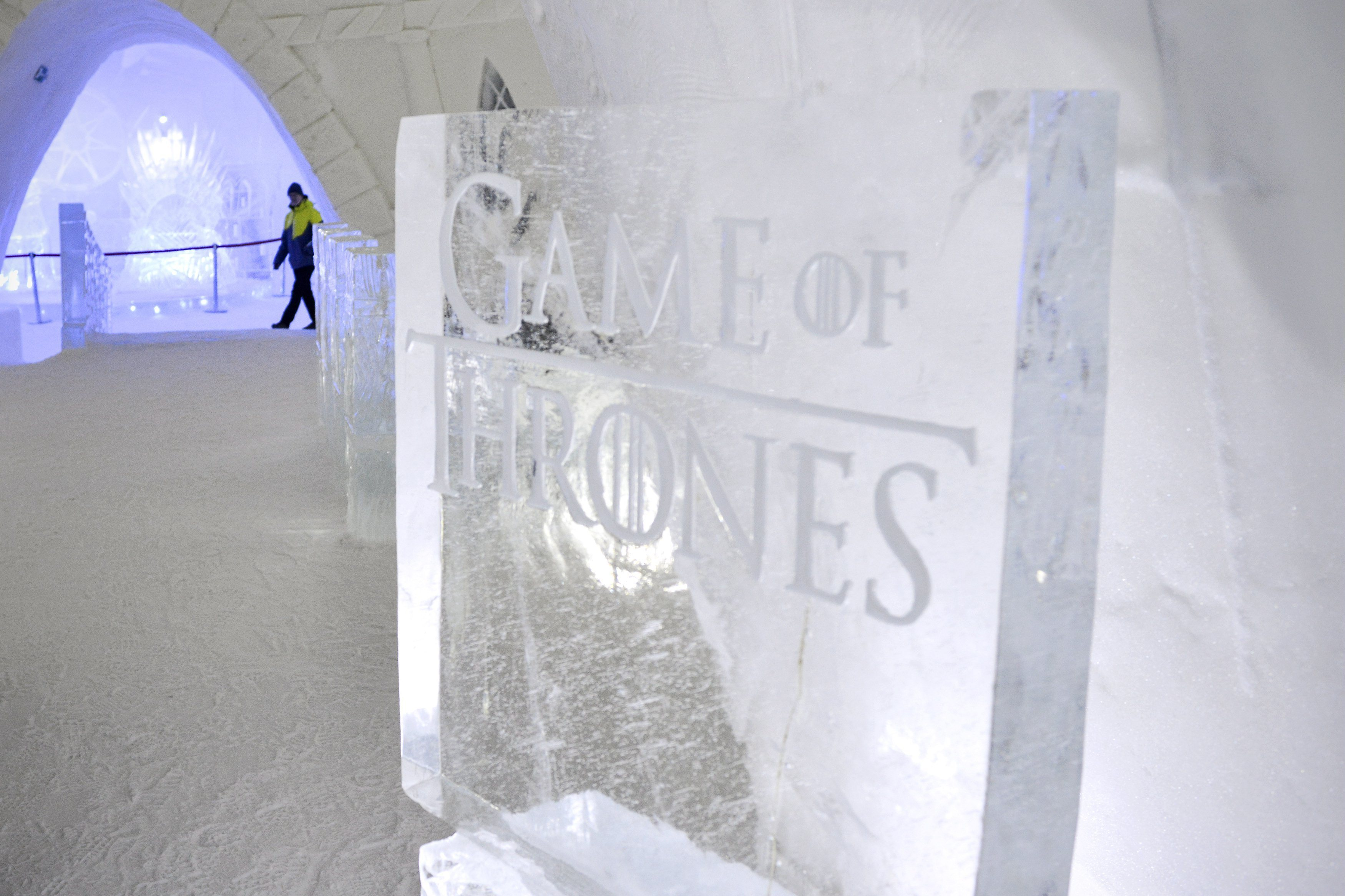 "A person  walks inside a  Game of Thrones-themed ice hotel in Kittila  Finnish Lapland on Sunday Jan. 14, 2018. A ""Game of Thrones""-themed ice hotel complete with a bar and a chapel for weddings has opened in northern Finland in a joint effort by a local hotel chain and the U.S. producers of the hit TV series. Lapland Hotels said Friday they chose ""Game of Thrones"" to be the theme for this season's Snow Village, an annual ice-and-snow construction project covering 20,000 square meters (24,000 sq. yards) in Kittila, 150 kilometers (93 miles) above the Arctic Circle.(Aku H'yrynen/Lehtikuva via AP)"