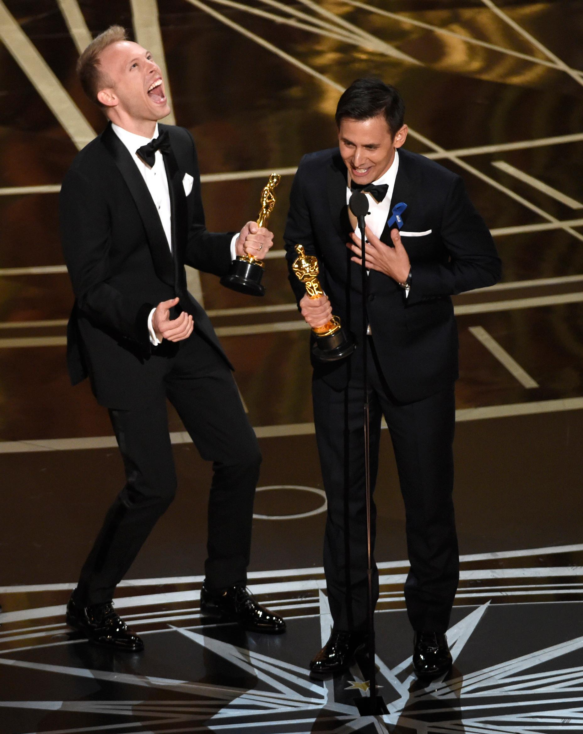 "File- This Feb. 26, 2017, shows  Justin Paul, left and Benj Pasek, right, accepting the award for best original song for ""City of Stars"" from ""La La Land"" at the Oscars at the Dolby Theatre in Los Angeles. The Fox network is getting in the Christmas spirit with its announcement Friday of ""A Christmas Story,"" a live TV musical scheduled for December.  Pasek and Paul, recent Tony Award nominees for the musical ""Dear Evan Hansen,"" and lyricists of ""La La Land's"" Oscar-winning song, ""City of Stars,"" also scored ""A Christmas Story: The Musical."" They will compose new songs for the television version.(Photo by Chris Pizzello/Invision/AP, File)"