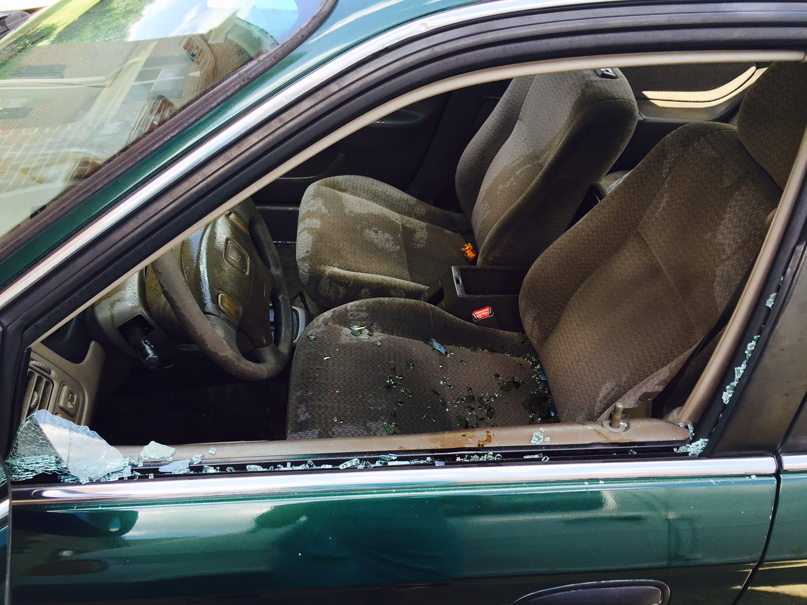 Seven windows between three vehicles were broken