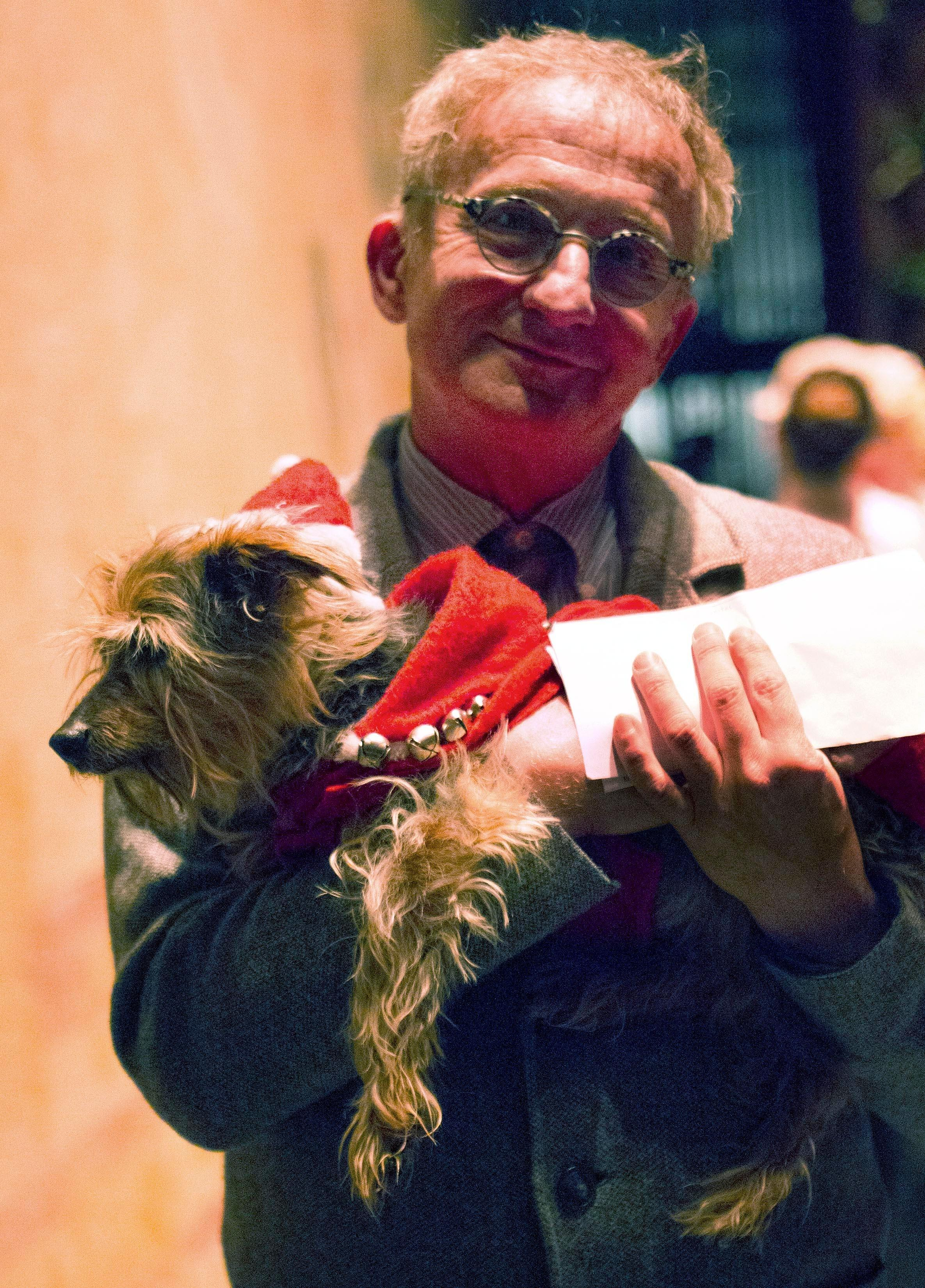 "In this undated photo provided by Festival Ballet Providence, Misha Djuric, the ballet company's artistic director, holds Archie, his Yorkshire Terrier, who has performed in more than 125 performances of ""The Nutcracker."" (Dylan Giles/Festival Ballet Providence via AP)"