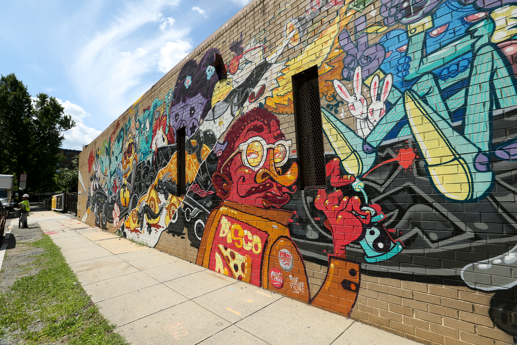 This mural isn't a part of Pow! Wow! but it is located in NoMa and it's publicly accessible. NoMa is quickly becoming a hub for urban art so there's plenty to see. (Amanda Andrade-Rhoades/DC Refined){ }