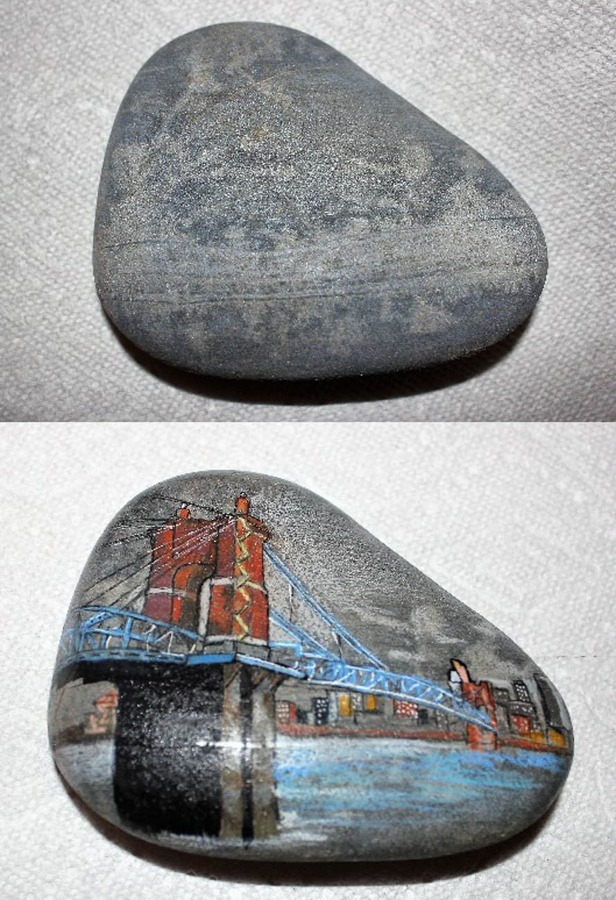 Artist John Grote says he was inspired by the markings in this rock that he found to create a beautiful depiction of the Roebling Suspension Bridge and Cincinnati riverfront. / Image:{ }John Grote // Published: 8.17.19