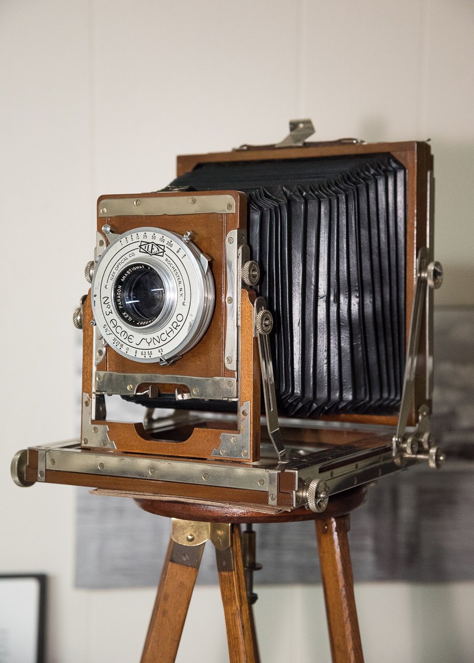 Tim received this old camera from a friend who lives in Camp Dennison. He says it came with a suitcase, and he mounted it on top of a 1910 tripod. / Image: Phil Armstrong, Cincinnati Refined // Published: 2.25.19