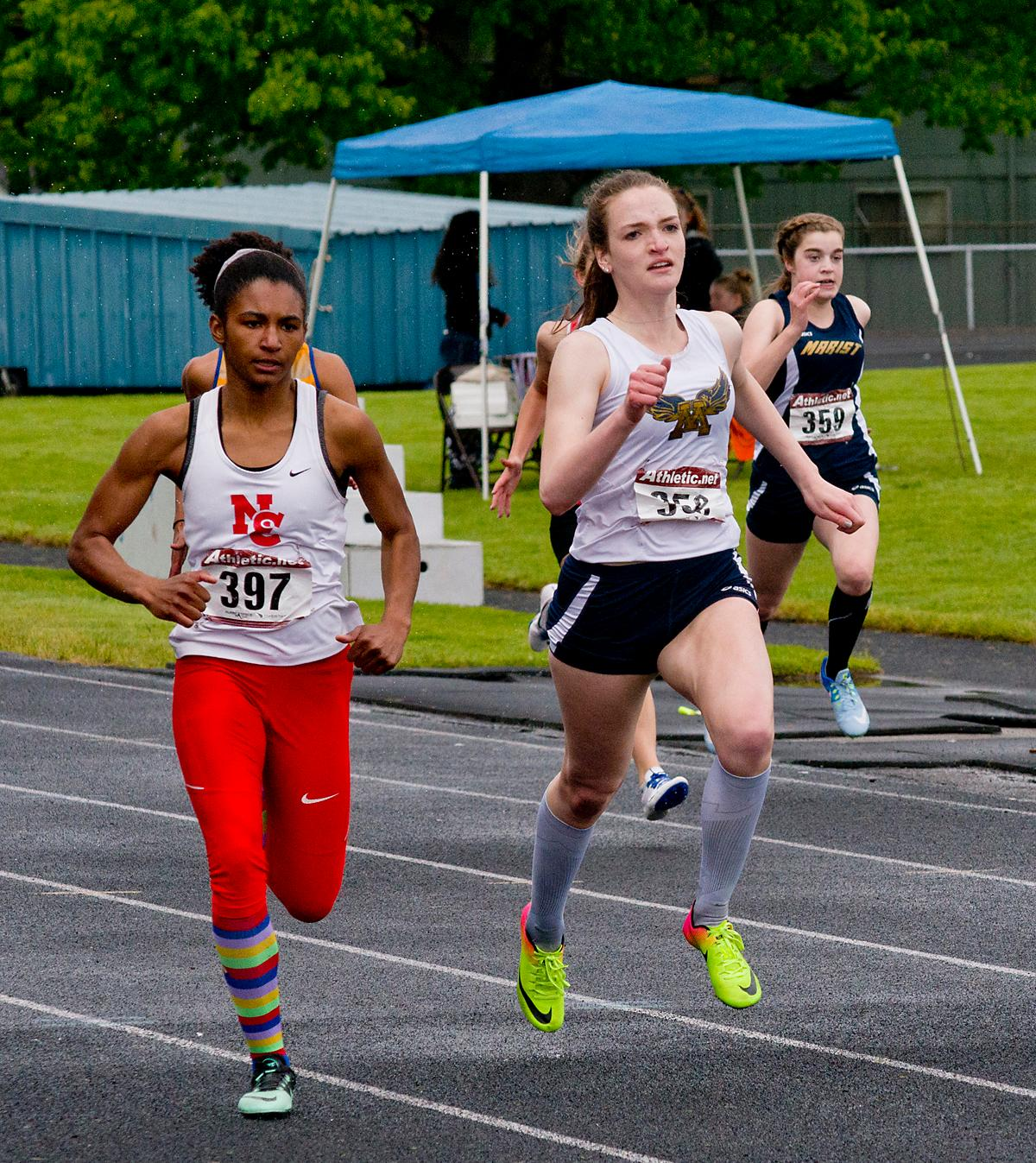 Nina Richardson (left) from North Eugene wins the 200 meter dash with a time of 26.32 at the 5A-3 Midwestern League District Track Meet. Photo by Dan Morrison, Oregon News Lab