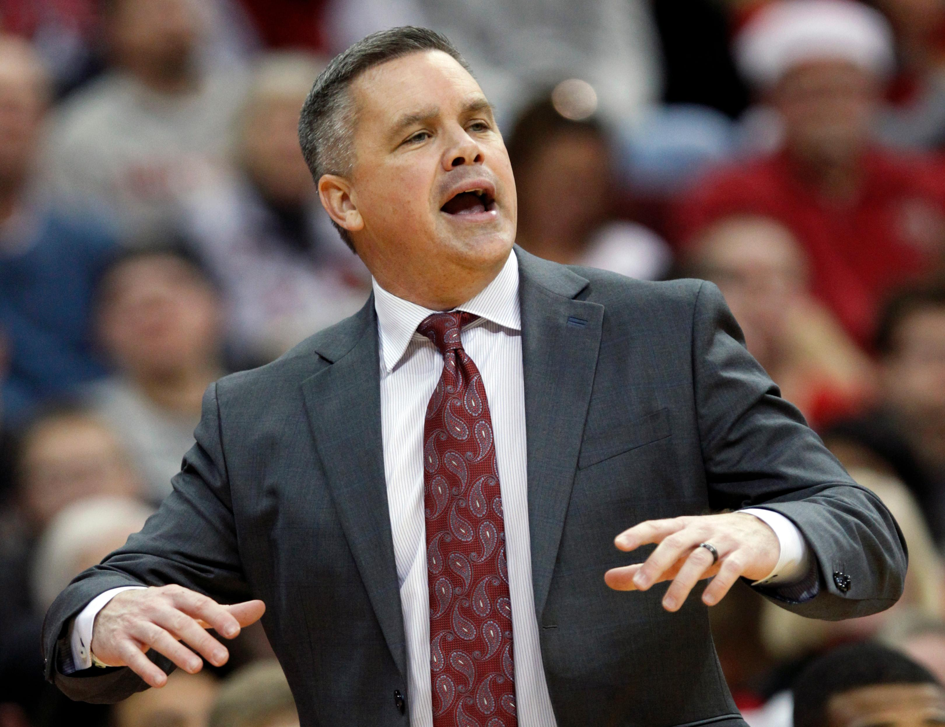 FILE - In this Dec. 16, 2017, file photo, Ohio State coach Chris Holtmann directs his team against Appalachian State during the second half of an NCAA college basketball game, in Columbus, Ohio. Ohio State's Keita Bates-Diop is The Associated Press player of the year in the Big Ten Conference and the Buckeyes' Chris Holtmann is its coach of the year. Bates-Diop and Purdue's Carsen Edwards were unanimous picks to the AP All-Big Ten team, also announced Wednesday, Feb. 28, 2018, in voting by 12 journalists covering the conference. (AP Photo/Paul Vernon, File)