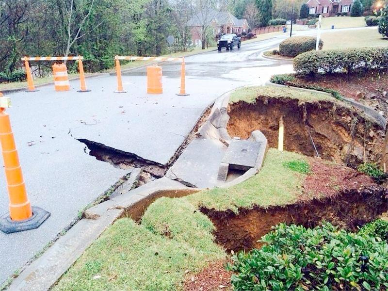 Flash flooding eroded a portion of road at the Quail Ridge subdivision in Pelham, Ala., Monday, April 7, 2014.