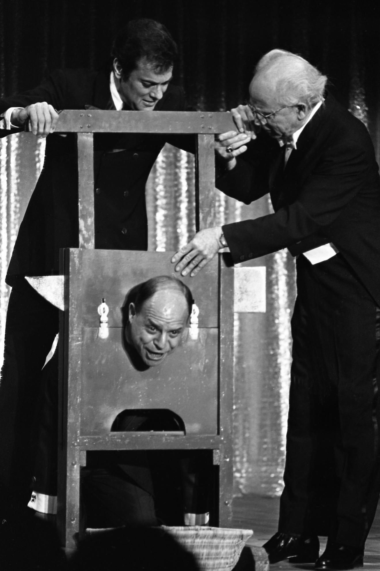 "Tony Curtis hosting ""Hollywood Palace"" during a magic act cutting off Don Rickles head at Caesars Palace on Nov. 2, 1967. [Las Vegas News Bureau file photo]"