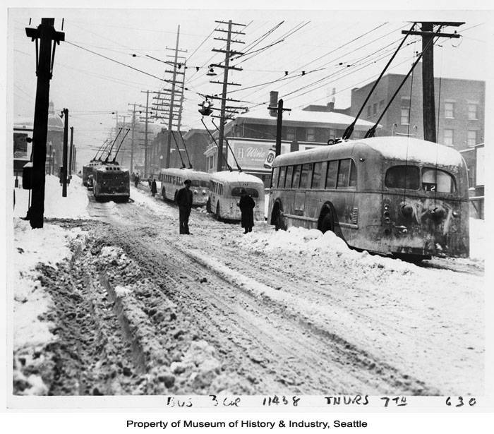 Record low temperatures and heavy snow plagued the Seattle area during the winter of 1950. On Friday January 13, downtown Seattle received an average of ten inches of snow, with Sea-Tac airport reporting 20.0 inches, just shy of a 24-hour snowfall record. Although the snow let up on Saturday, the cold temperatures persisted for several more days. Seattle recorded nine days of temperatures below ten degrees between January 12 and February 4, 1950. (Photo: Museum of History & Industry, Seattle Image 1986.5.14568.1)