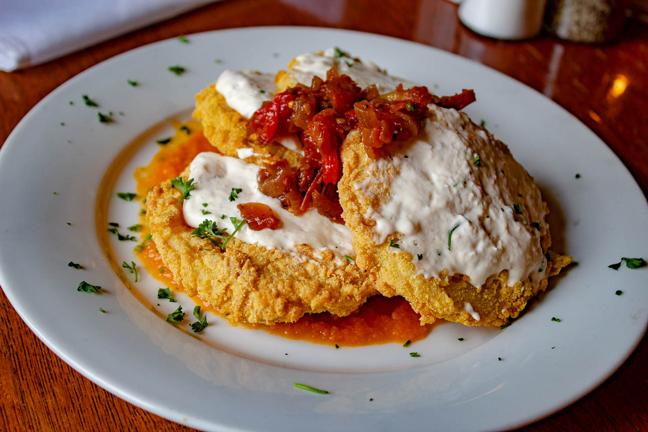 Fried green tomatoes: cornmeal dusted tomatoes and cream cheese mousse topped with scallions and sweet tomato chutney / Image: Katie Robinson, Cincinnati Refined // Published: 11.11.19