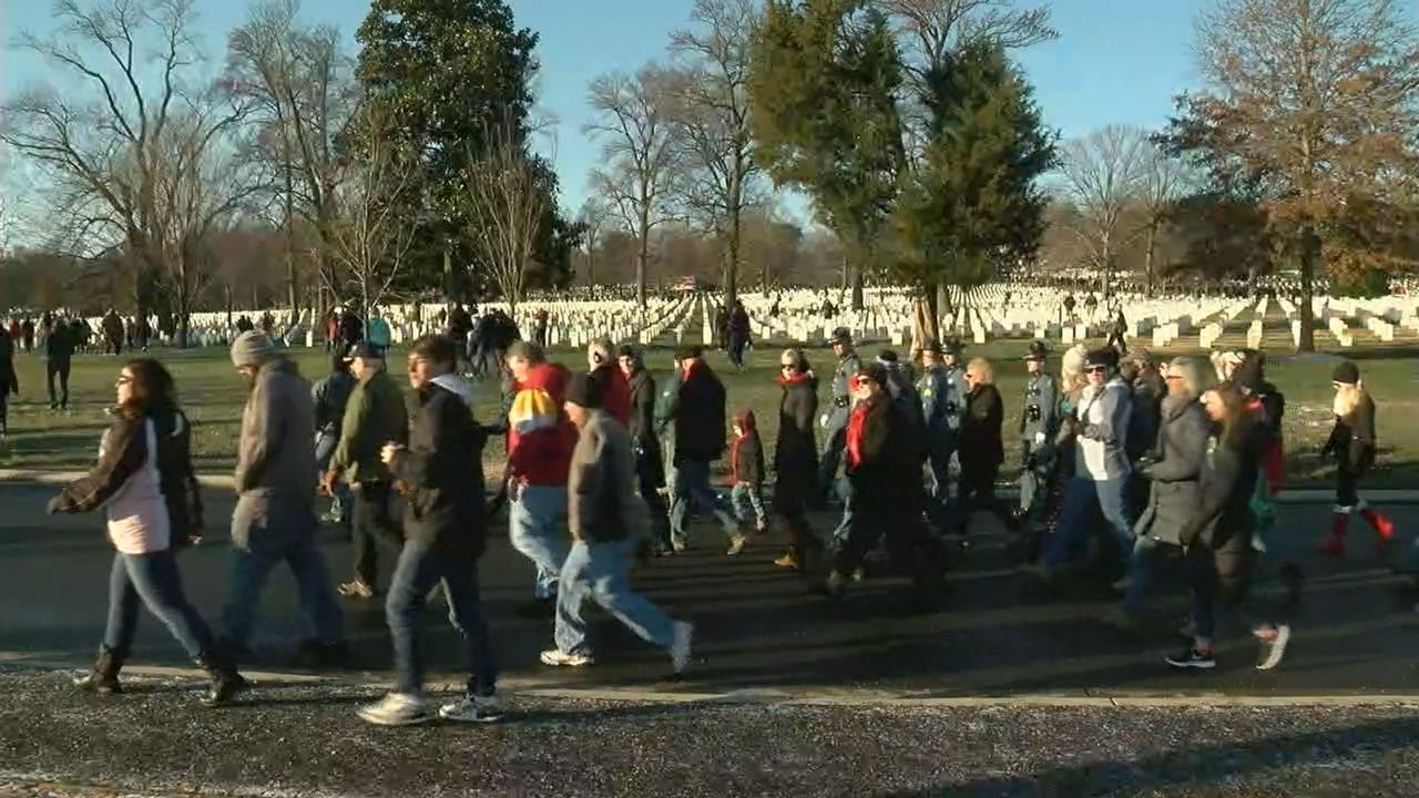 Over 50,000 volunteers lay wreaths on headstones at National Arlington Cemetery . (ABC7)<p></p>