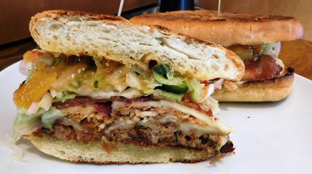 The Cuban Defector.   John Howie Steak, located in downtown Bellevue, brings major sandwich game. Every day the steakhouse features a unique and new sandwich called they call #SandwichOfTheDay. Enjoy the gallery! These are just a few of the daily sandwiches that look absolutely mind-blowing. To see the current Sandwich of the Day, check out John Howie Steak's Facebook page. (Image courtesy of John Howie Steak)