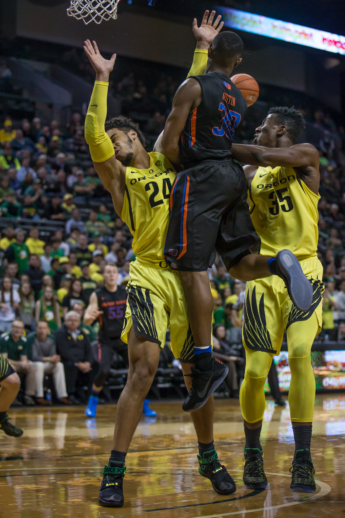 Oregon forward Dillon Brooks (#24) takes a charge from Boise State guard Paris Austin (#30). After trailing for most of the game, the Oregon Ducks defeated the Boise State Broncos 68-63. Photo by Dillon Vibes