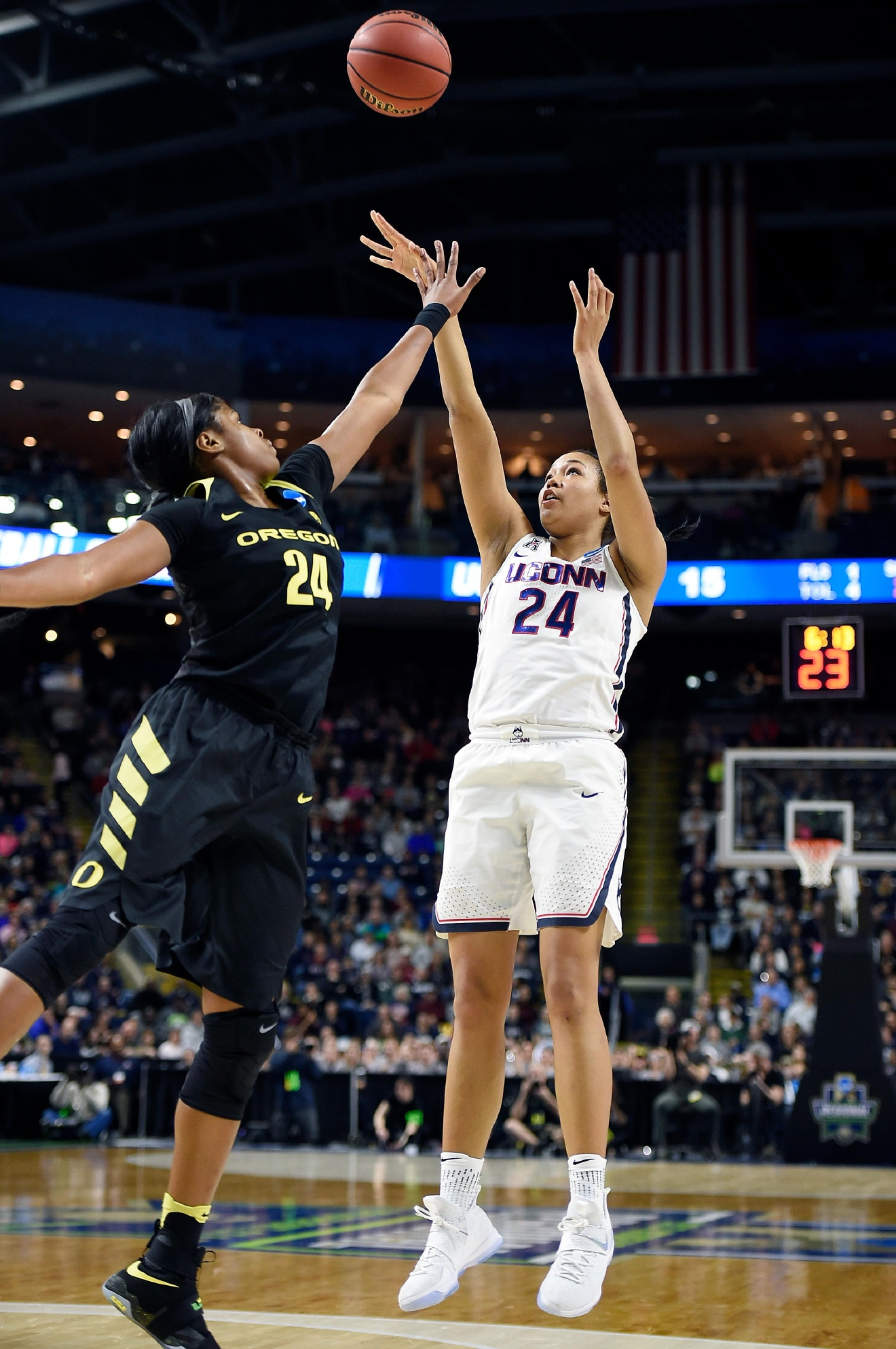 Connecticut's Napheesa Collier, right, shoots over Oregon's Ruthy Hebard during the first half of a regional final game in the NCAA women's college basketball tournament, Monday, March 27, 2017, in Bridgeport, Conn. (AP Photo/Jessica Hill)