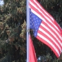 Pasco couple keeps American flag and U.S. Marine Corps flag flying upside down