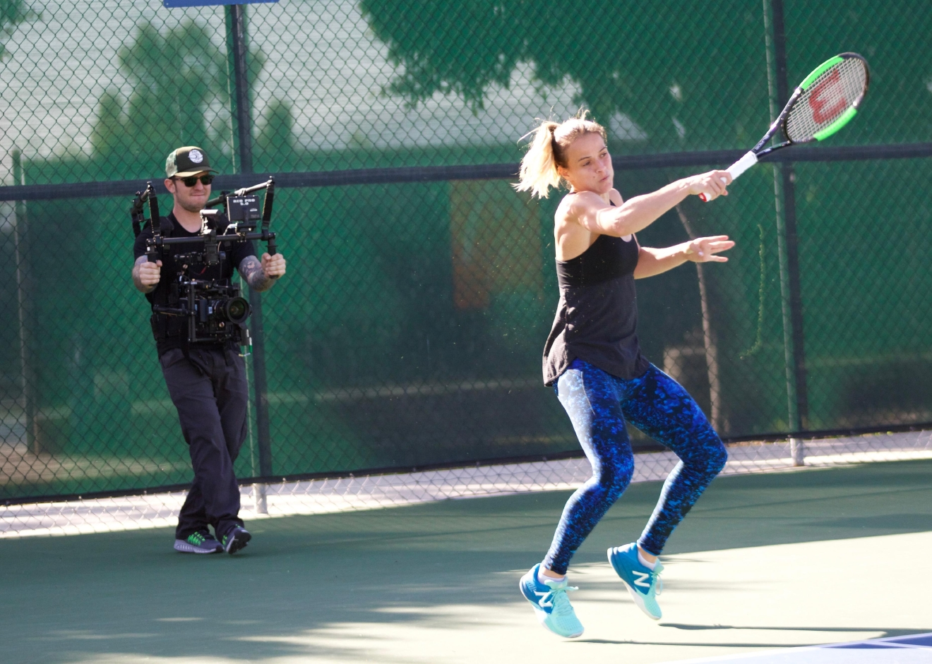 Nicole firing a forehand while shooting the 'My Tennis Life' trailer