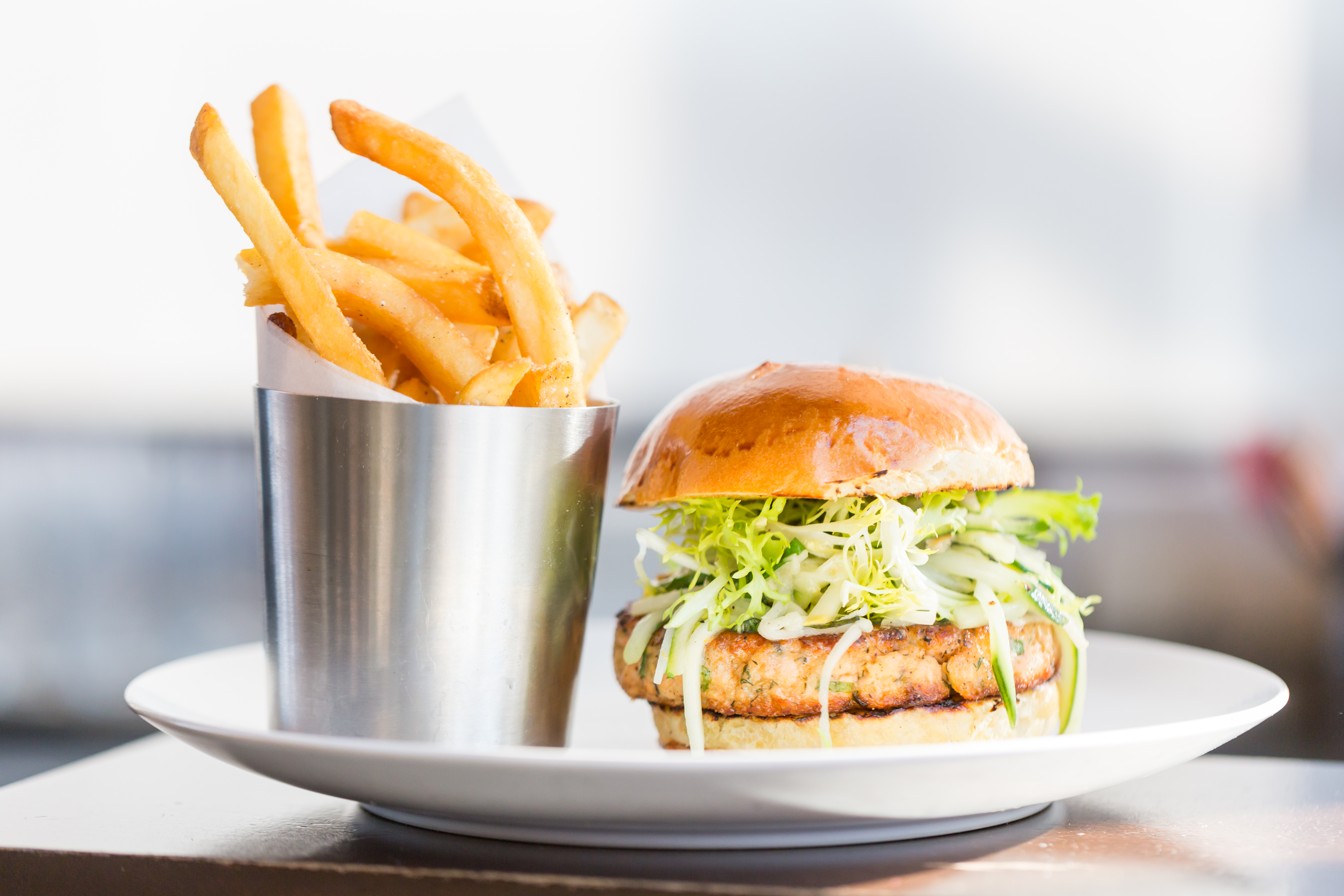 <p>Salmon Burger: charred squash, kohlrabi slaw and basil-yuzu aioli (Image: Courtesy District Winery)</p>