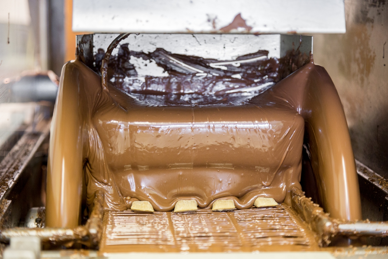 Additional tempered chocolate is added to the candies. / Image: (Daniel Smyth Photography