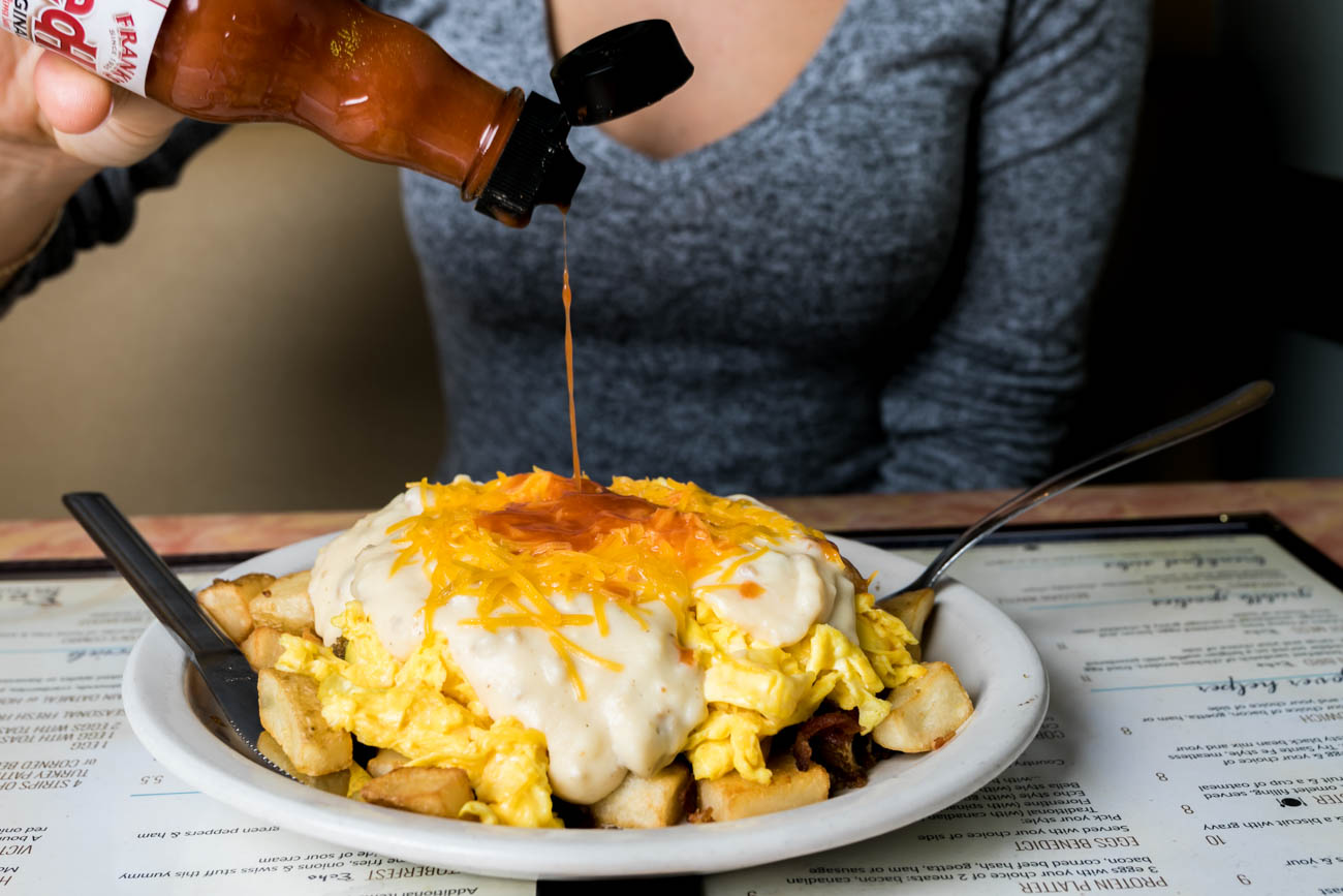 The Hot Mess: layers of home fries, scrambled eggs, bacon, and sausage smothered in sausage gravy and cheddar cheese with a side of toast / Image: Amy Elisabeth Spasoff // Published: 2.20.18