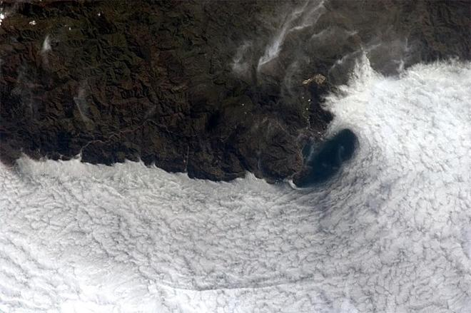An eddy of air swirls around the Black Sea coast, made beautifully visible by fog on the water. (Photo & Caption: Chris Hadfield/NASA)