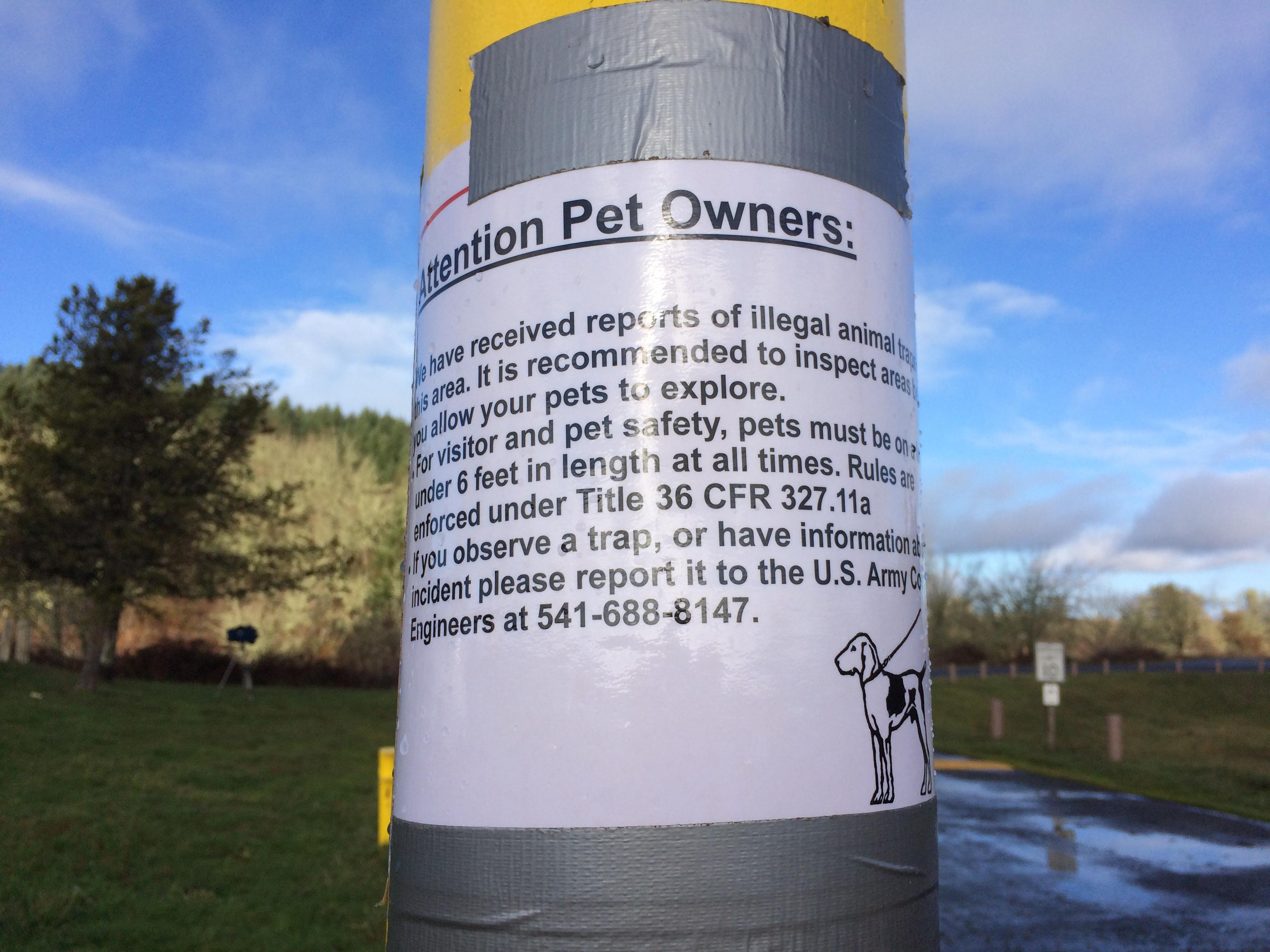 <p>The Army Corps posted a sign warning visitors of &quot;illegal animal traps&quot; and urging dog owners to keep their pets on 6-foot leashes at all times. &quot;It is recommended to inspect areas before you allow your pets to explore,&quot; the sign says. (SBG)</p>