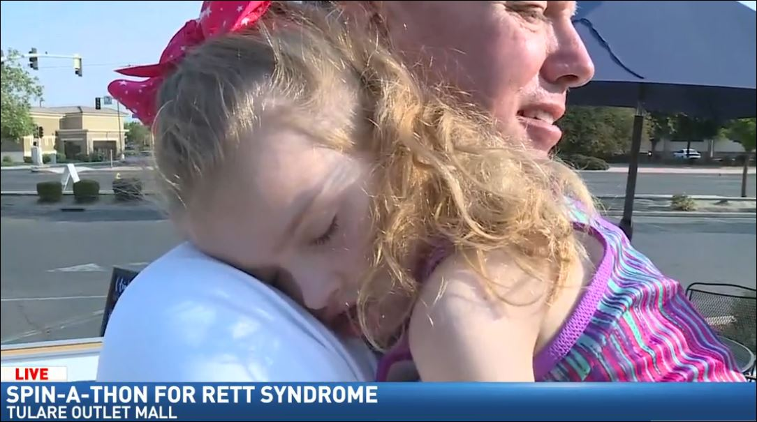 Wendi Lane spent the morning talking to Don Sercy, whose granddaughter was born with Rett syndrome.