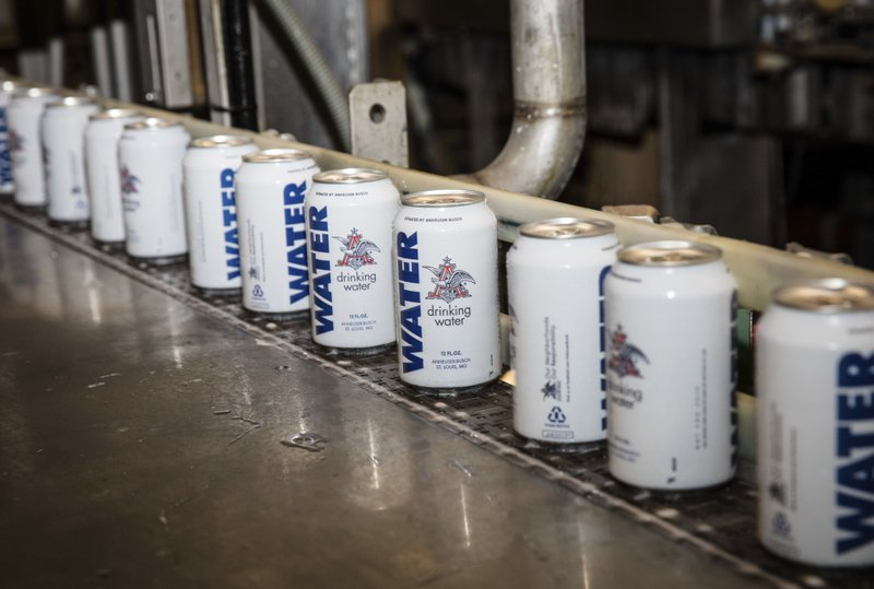 This undated photo provided by Anheuser-Busch shows rows of canned water in Cartersville, Ga. The brewery is shipping canned drinking water to the American Red Cross to help Hurricane Harvey relief efforts in Texas and Louisiana. (Anheuser-Busch via AP)