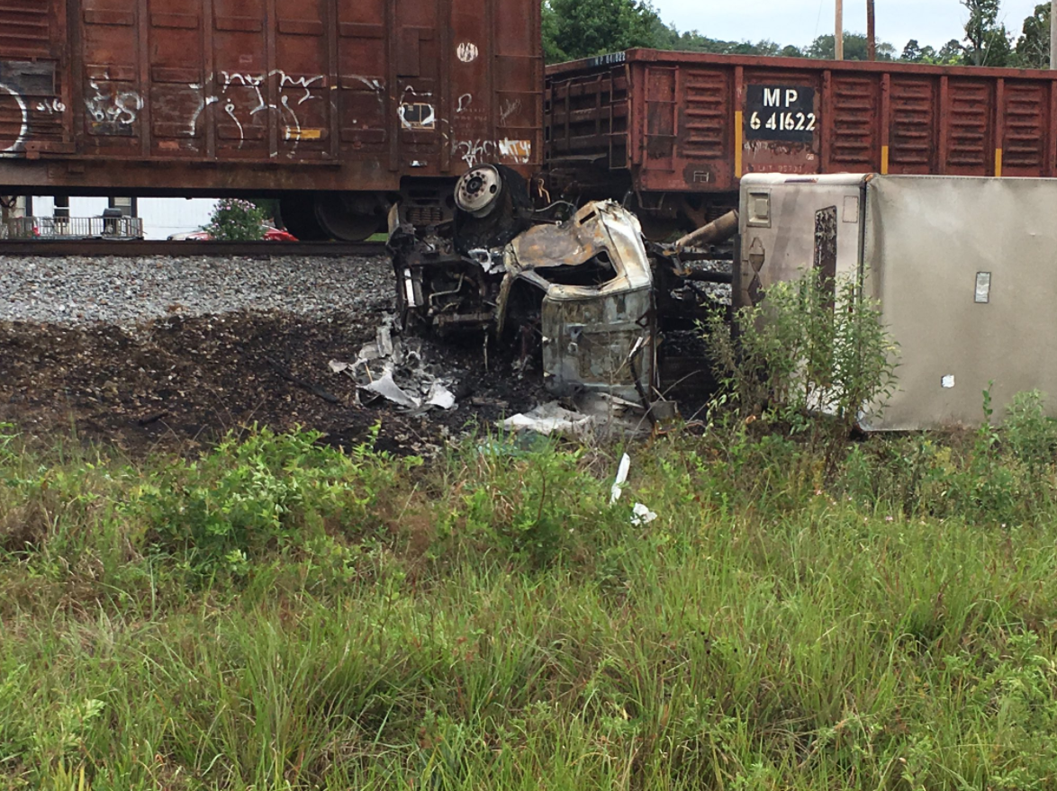 When the train hit the vehicle, the truck rolled onto its side and caught on fire. (KATV Photo)