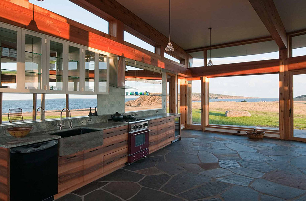 This San Juan Island Guesthouse was completed by Rohleder Borges Architecture and features a stone veneer, floor and cedar structure.   (Image: San Juan Island Guesthouse / Porch.com)