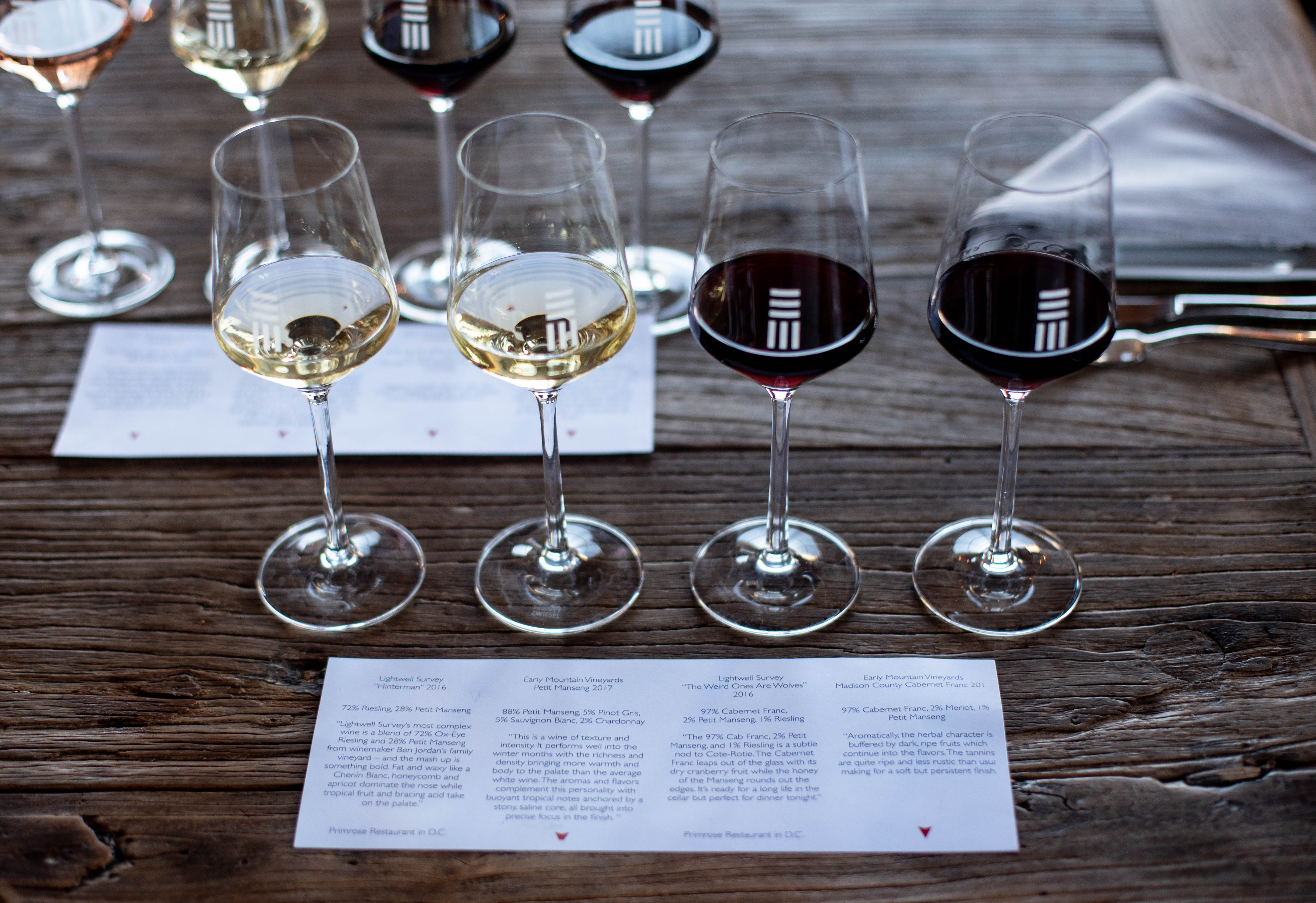 Snag a space at their tasting bar for a sampling of their current wine releases ($12); $18 gets you 9 pours of their top tipples and a take-home glass. (Image: Courtesy Early Mountain Vineyards)