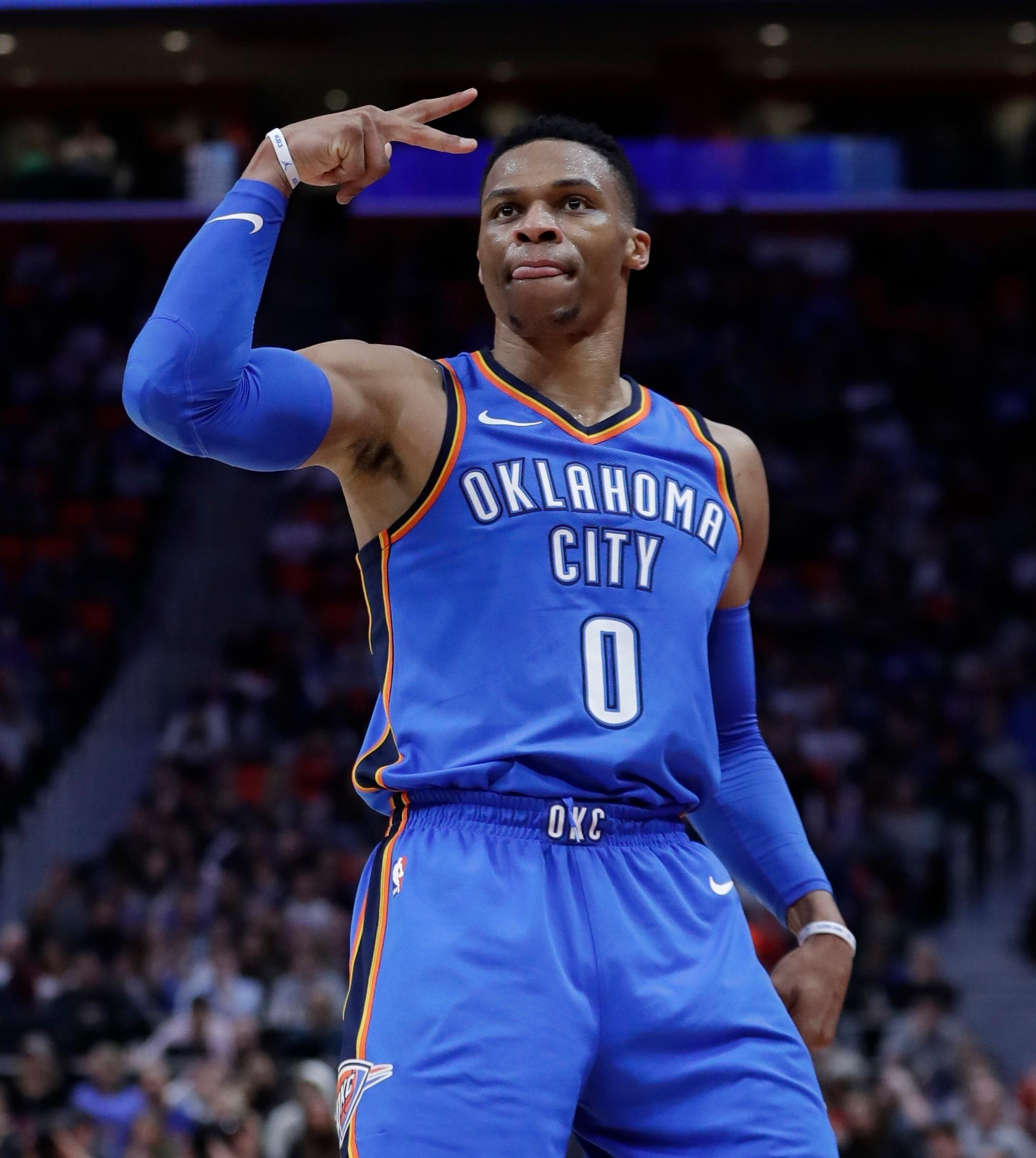Oklahoma City Thunder guard Russell Westbrook gestures after a basket against the Detroit Pistons during the second half of an NBA basketball game Saturday, Jan. 27, 2018, in Detroit. (AP Photo/Carlos Osorio)