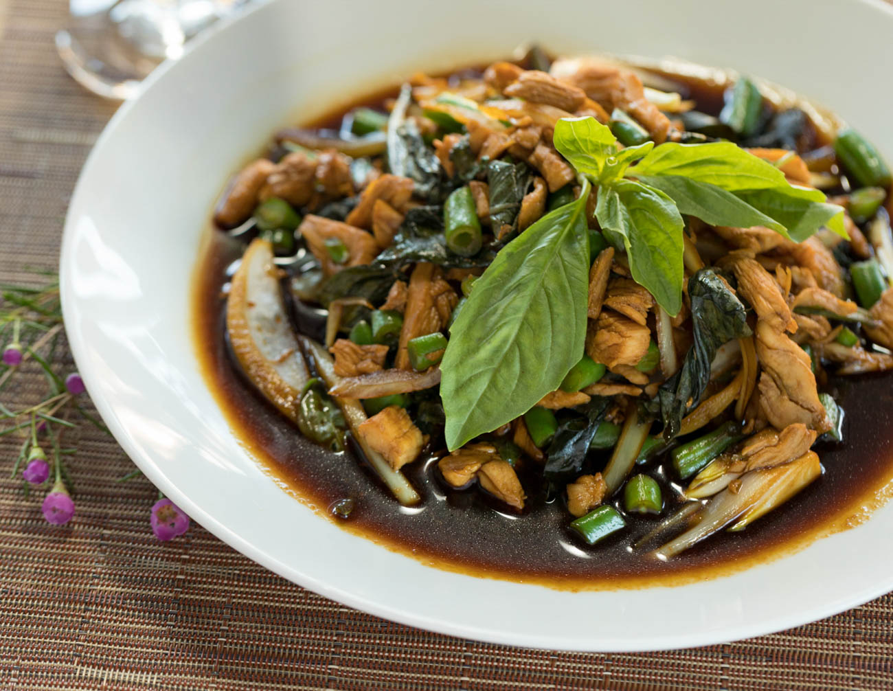 Chicken basil country style stir-fry: beef or chicken with green bean, white onion, and fresh basil in Thai local basil sauce{ }/ Image: Marlene Rounds // Published: 1.17.19