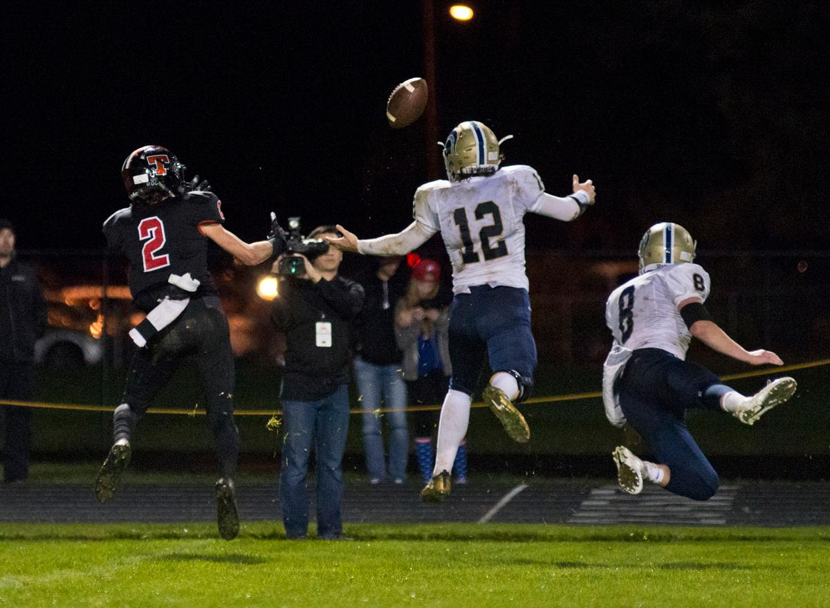 Thurston Colts wide receiver (#2), Marist Spartans linebacker Mitchell Hopkins (#12 and Jace Krier (#8) leap for a long pass. Thurston defeated Marist 50 to 14 to seal the second position in their conference. Photo by Dan Morrison, Oregon News Lab