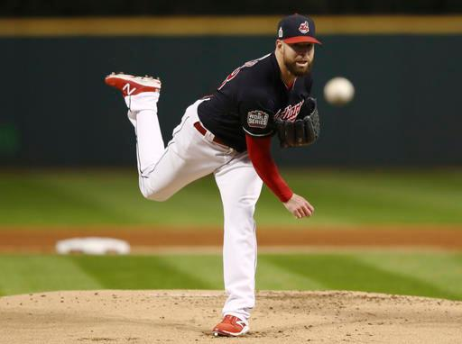 Cleveland Indians starting pitcher Corey Kluber throws during the first inning of Game 1 of the Major League Baseball World Series against the Chicago Cubs Tuesday, Oct. 25, 2016, in Cleveland. (AP Photo/Elsa Garrison)
