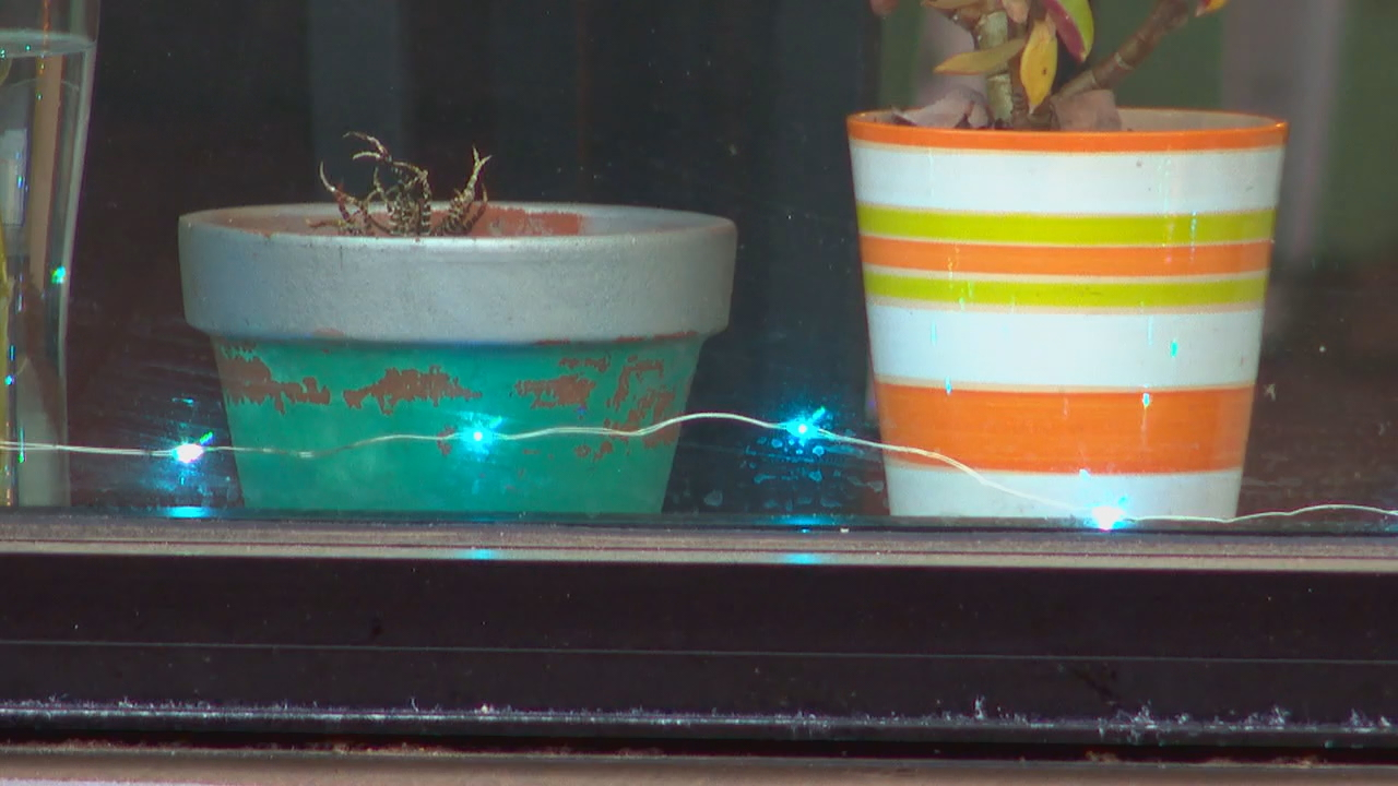 Although the holidays are over, several downtown Asheville business owners have come together to put holiday lights back in the windows and doorframes of their storefronts after learning that many frontline and essential workers got a little bit of joy seeing them on their way into work or after a long day. (Photo credit: WLOS Staff)