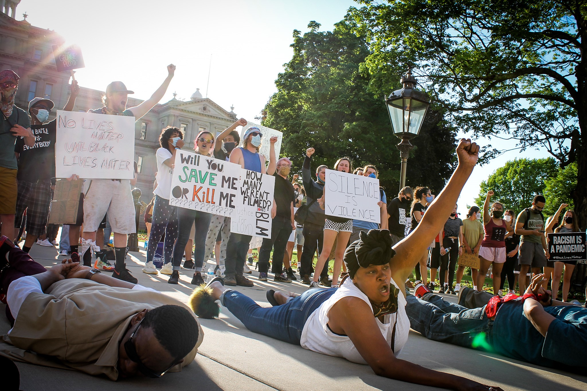 "Chants of ""I can't breathe,"" ""Hands up, don't shoot,"" and ""Black lives matter"" echoed across the Michigan capitol grounds on June 3, 2020. (WWMT/Mikenzie Frost)"