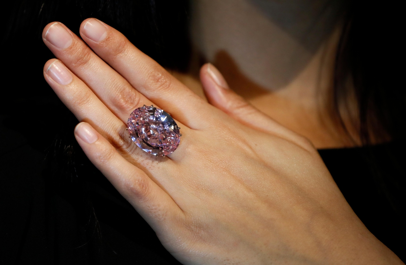 The Pink Star diamond, the most valuable cut diamond ever offered at auction is displayed by a model at Sotheby's auction rooms in London, Monday, March 20, 2017. It is the largest internally flawless fancy vivid pink diamond ever graded by the GIA. The diamond estimated in excess of 60 million US Dollars will go for auction in Hong Kong on April 4. (AP Photo/Kirsty Wigglesworth)