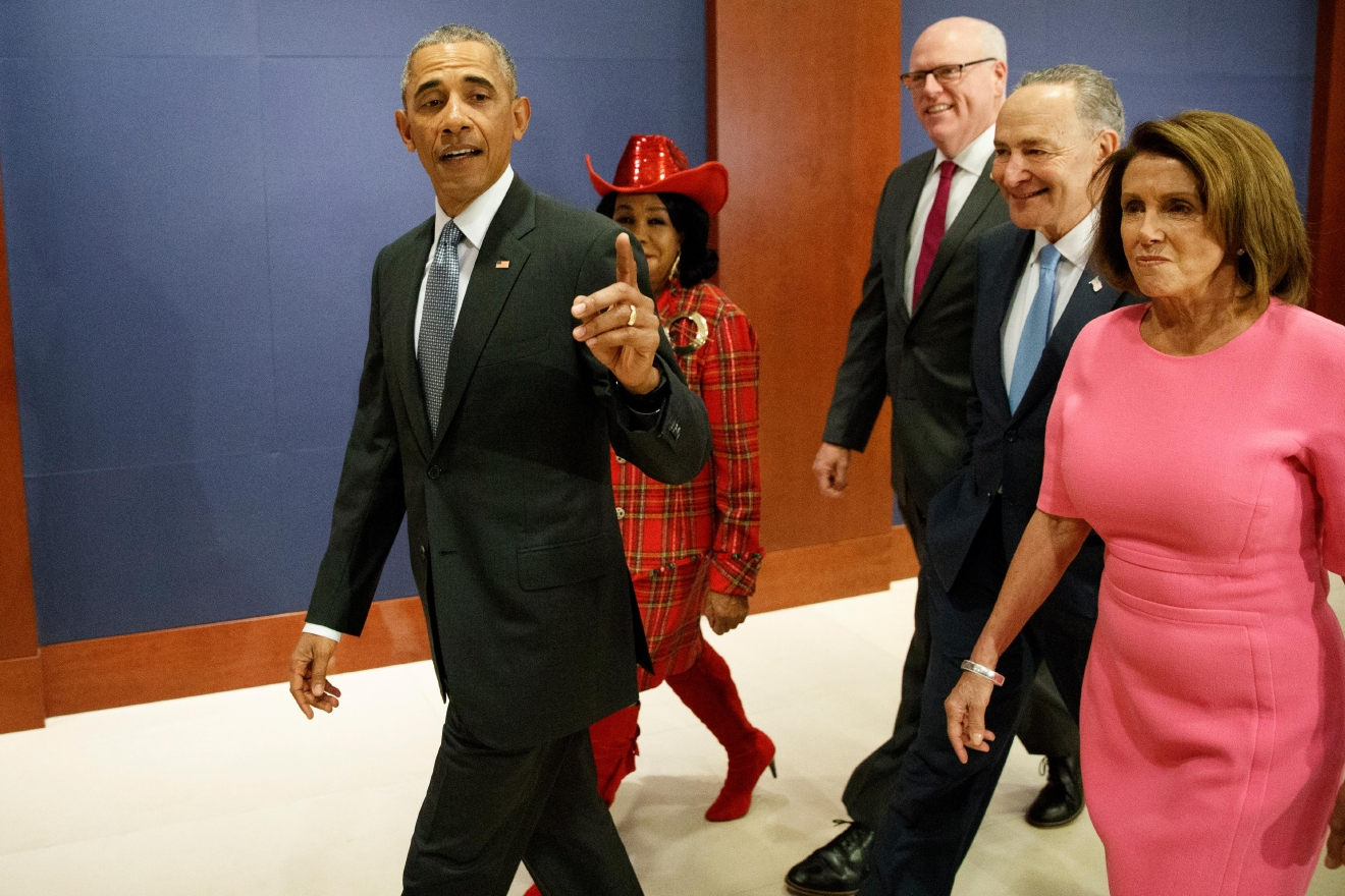 President Barack Obama, joined by, from second from left, Rep. Frederica Wilson, D-Fla., Rep. Joseph Crowley, D-N.Y., Senate Minority Leader Charles Schumer of N.Y., and House Minority Leader Nancy Pelosi of Calif. arrives on Capitol Hill in Washington, Wednesday, Jan. 4, 2017. (AP Photo/Evan Vucci)