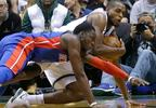 Milwaukee Bucks' Khris Middleton, top, vies for a loose ball with Detroit Pistons' Reggie Jackson, bottom, during the second half of a game Wednesday, Nov. 15, 2017, in Milwaukee. The Bucks won 99-95.