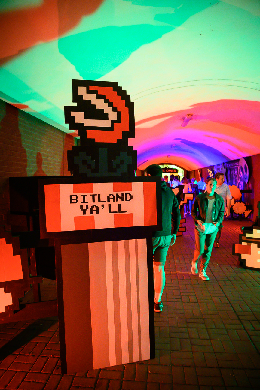 PICTURED NEIGHBORHOOD: Covington / The arcade that connects Pike and 7th Street in Covington interprets its namesake differently for BLINK by turning into a video game arcade-themed wonderland. / Image: Phil Armstrong // Published: 10.12.19