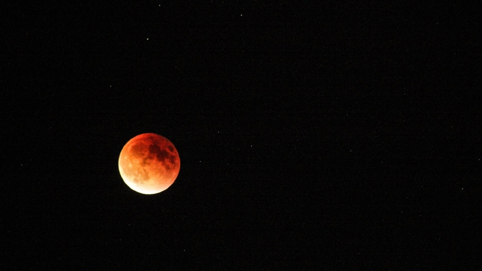 Photos: Rare supermoon eclipse over Pacific Northwest