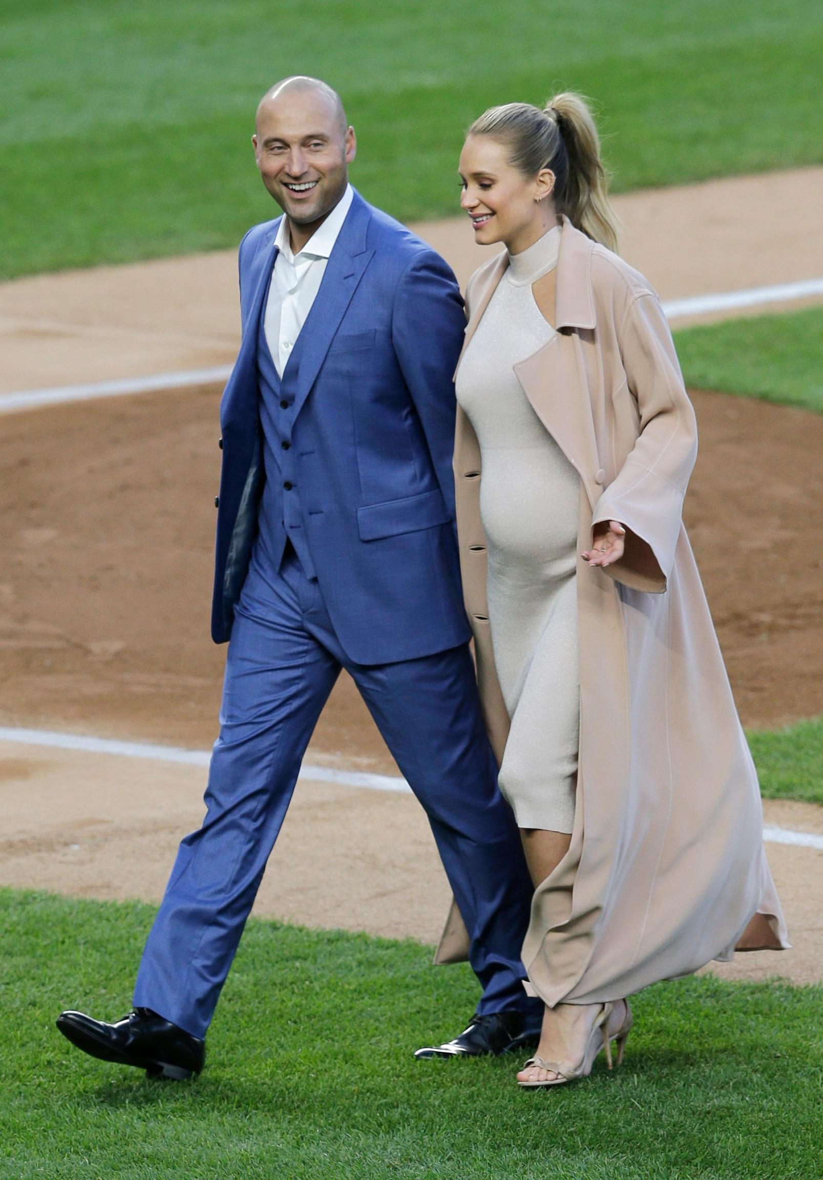 Former New York Yankee Derek Jeter and his wife Hannah Jeter leave the field after a ceremony retiring Jeter's number at Yankee Stadium, Sunday, May 14, 2017, in New York. (AP Photo/Seth Wenig)