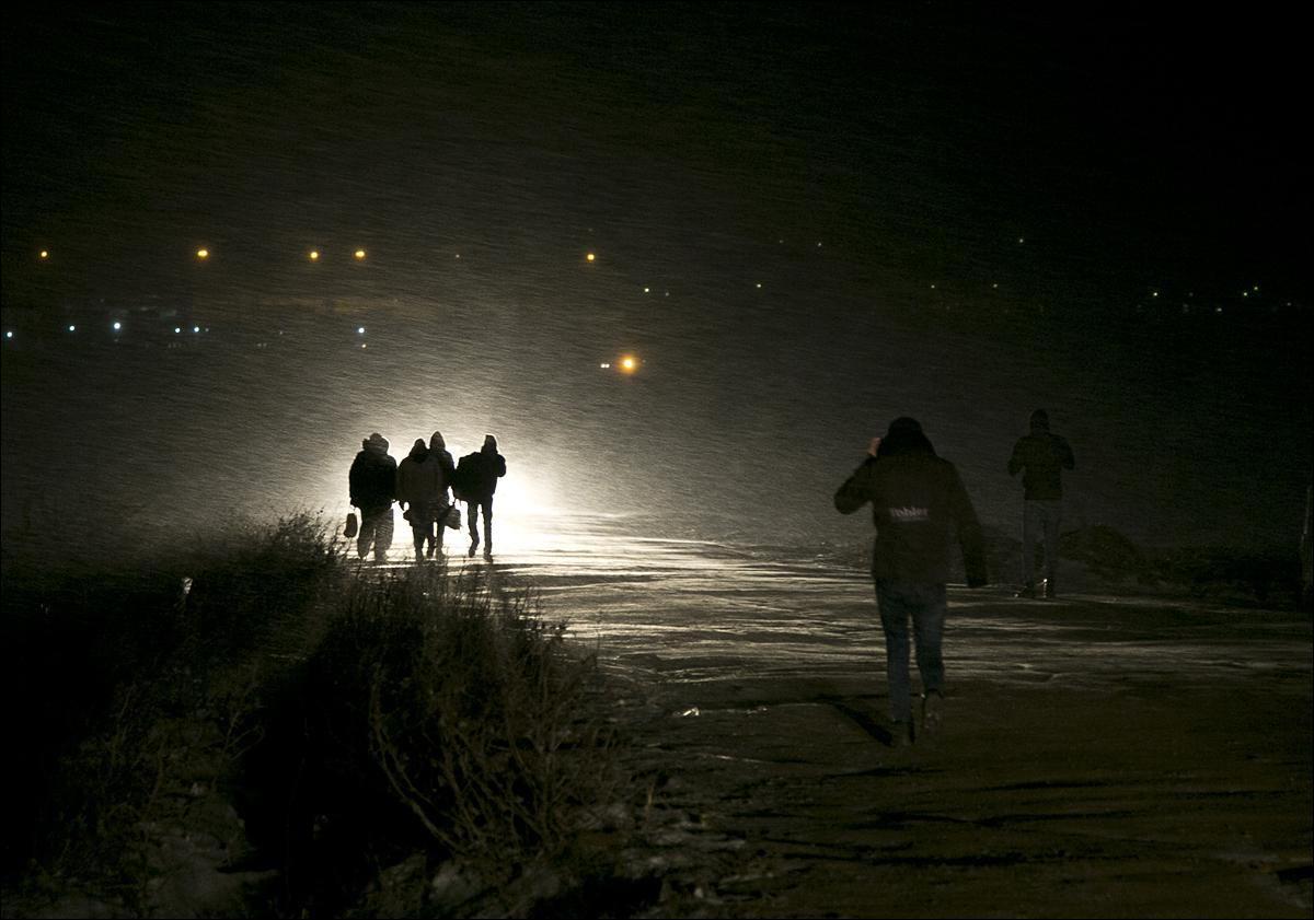 Migrants walk through a snowstorm from the Macedonian border into Serbia, near the village of Miratovac, Serbia, on Sunday, Jan. 17, 2016. Bracing cold temperatures and snow storms hundreds of migrants continue to arrive daily into Serbia in order to register and continue their journey further north towards Western Europe. (AP Photo/Visar Kryeziu)