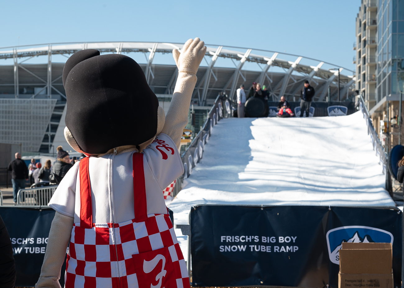 The Frisch's Big Boy Snow Tube Run is a 50-foot-long snow tube hill that's set up along Freedom Way. It's not uncommon to find Big Boy himself hamming it up around the ramp. / Image: Phil Armstrong, Cincinnati Refined // Published: 1.6.20