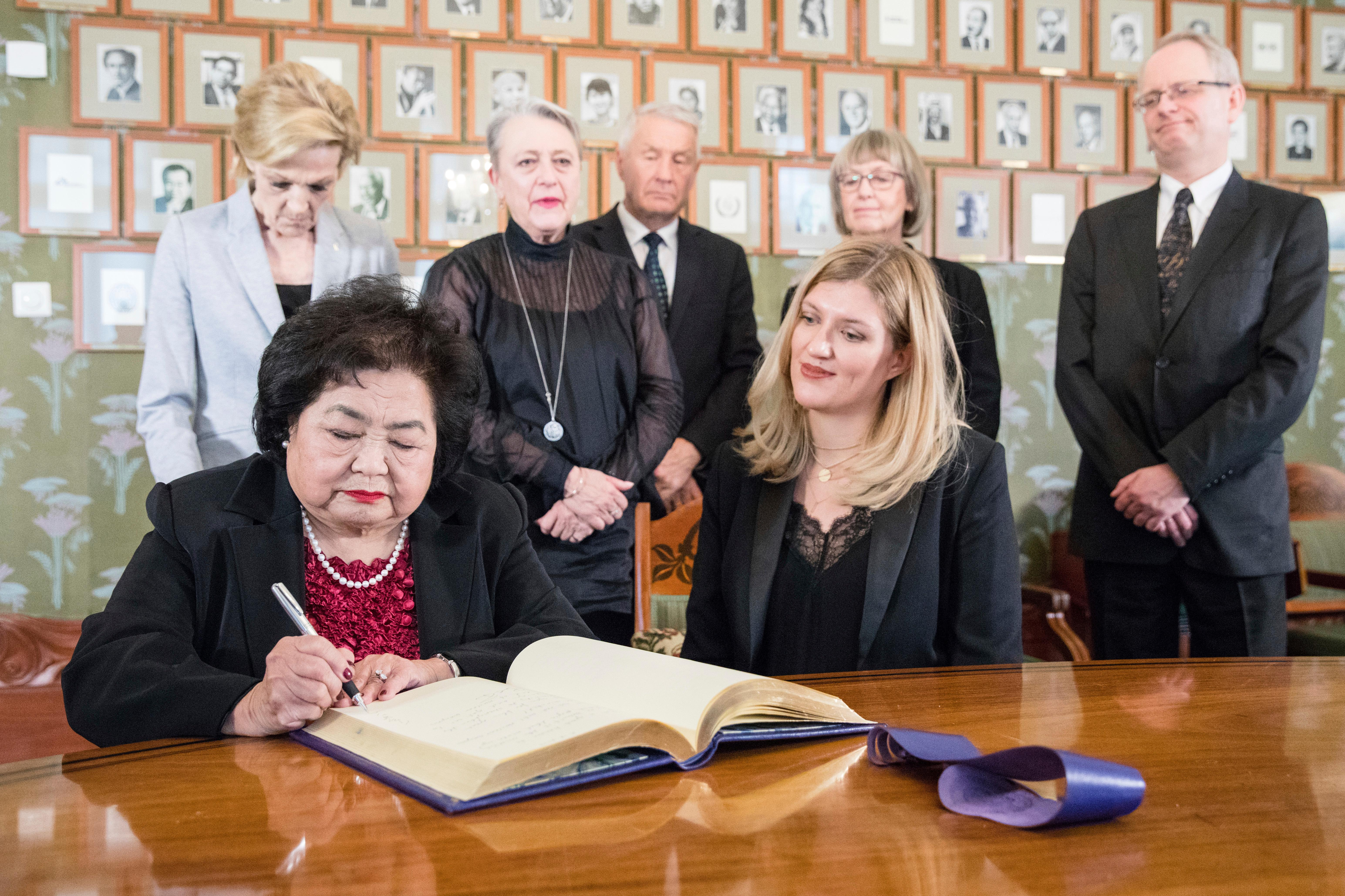 ICAN (International Campaign to Abolish Nuclear Weapons) campaigner and Hiroshima survivor, Setsuko Thurlow signs the Nobel protocol, during a press conference at the Norwegian Nobel Committee, in Oslo, Norway, Saturday, Dec. 9, 2017. As long as atomic bombs exist, a disaster is inevitable, the head of the International Campaign to Abolish Nuclear Weapons, the winner of this year's Nobel Peace Prize, said Saturday. (Audun Braastad/NTB scanpix via AP)